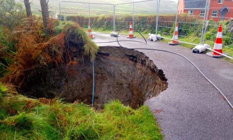 Sinkhole opens on rural roadside prompting safety concerns