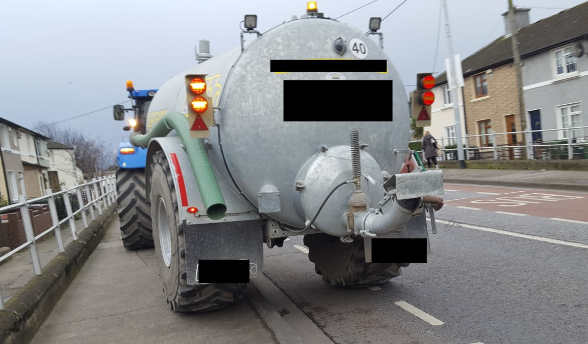 Tax trouble for tractor with tanker in town