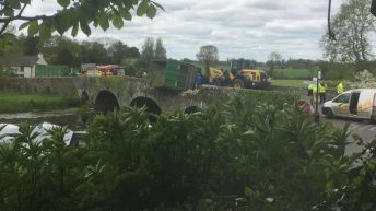 Narrow escape as silage trailer overturns on bridge