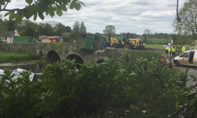 Narrow escape as silage trailer overturns on bridge