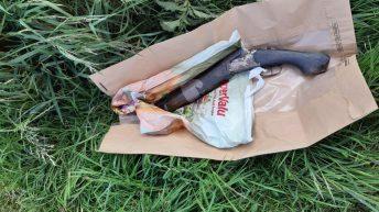 Sawn-off shotgun 'concealed behind water trough' in field