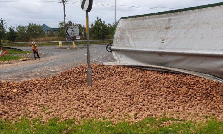 Trailer transporting potatoes overturns on Scottish road