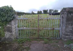Farmyard wrought iron gates and stone piers preserved