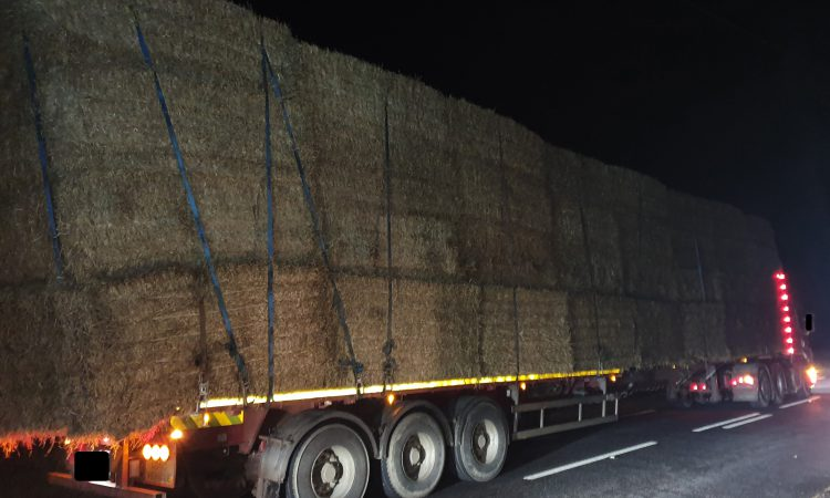 Court summons after extended flatbed lorry with straw stopped