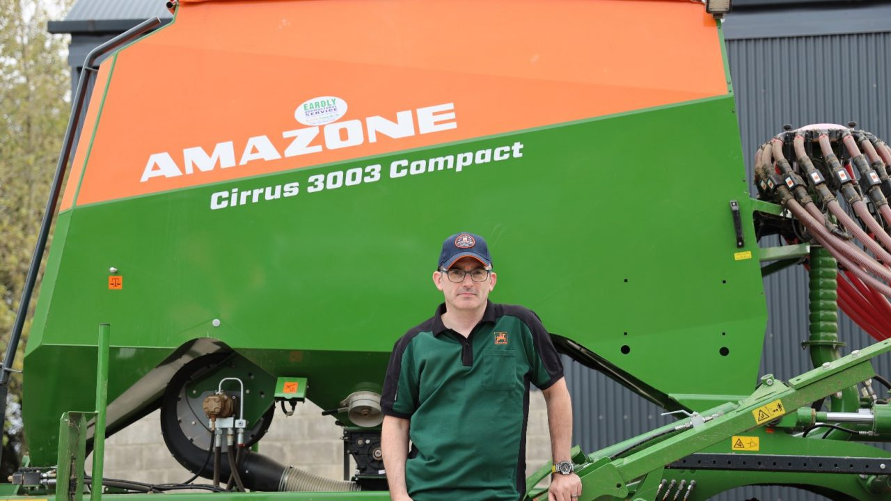 What trailed drill does this tillage farmer choose for planting his own corn?