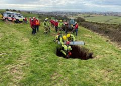Farmer rescued after falling down 60ft sinkhole in field