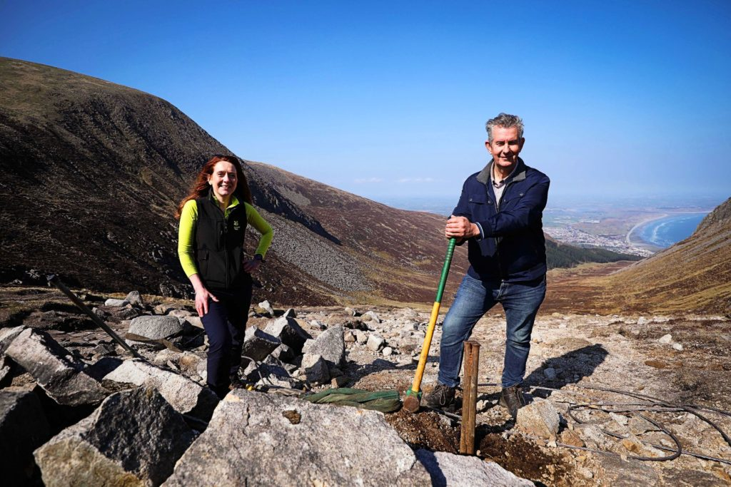 Agriculture Minister Edwin Poots helps National Trust maintenance work on Slieve Donard. Image source PressEye