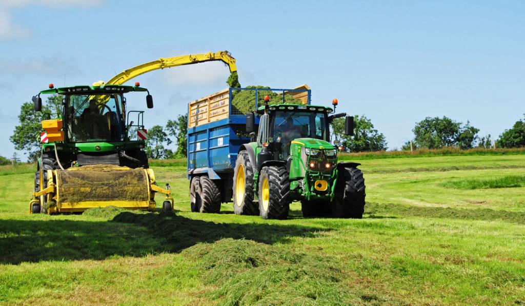 John Deere harvester on sheep paddocks