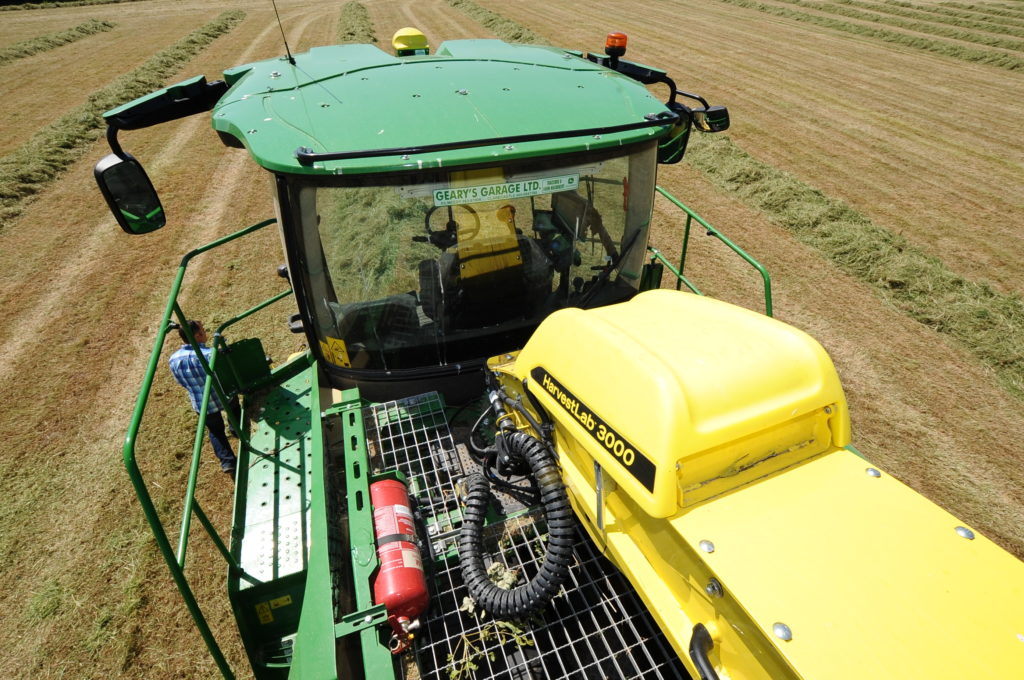 John Deere HarvestLab 3000 sits at the base of the the delivery chute