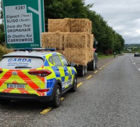 'Writing on the wall' for tractor driver drawing bales