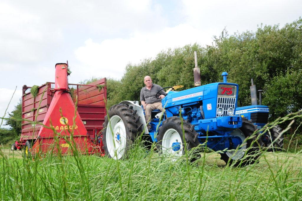 Roarsless Ploughmaster 75 in adjacent field