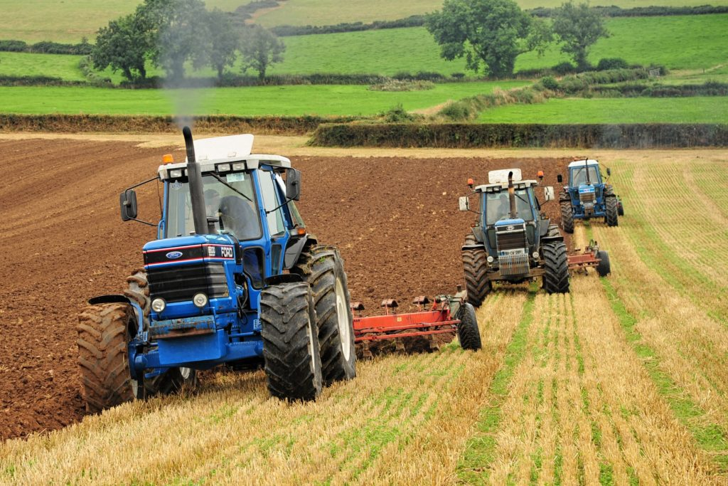 Tractors ploughing at Austin Rothwell